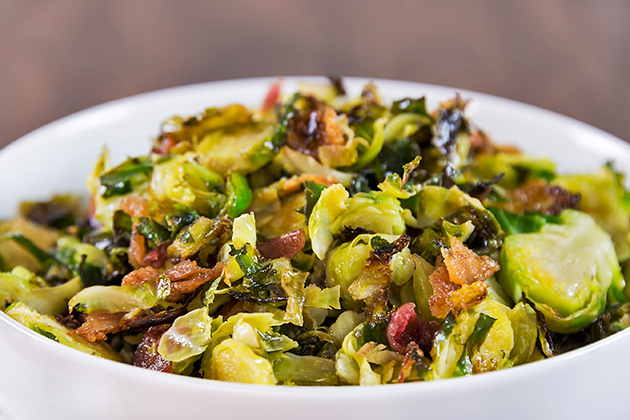 Shaved Brussel Sprouts Salad with Warm Candied Bacon Dressing